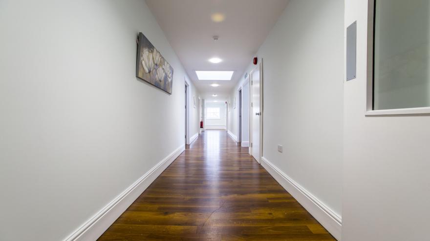 Caron Group Springbank hallway